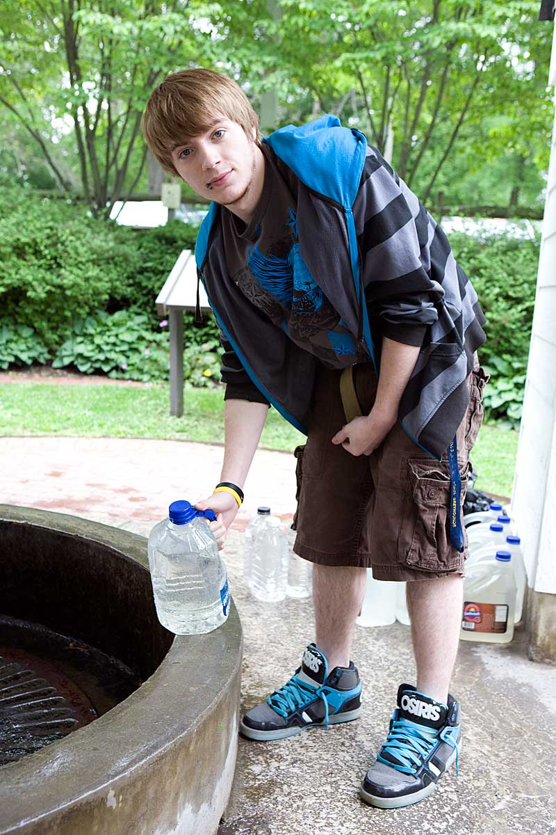 Young man getting water for his family, Flowing Well Park, Carmel IN
